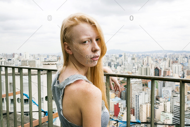 Woman with freckles over Sao Paolo, Brazil