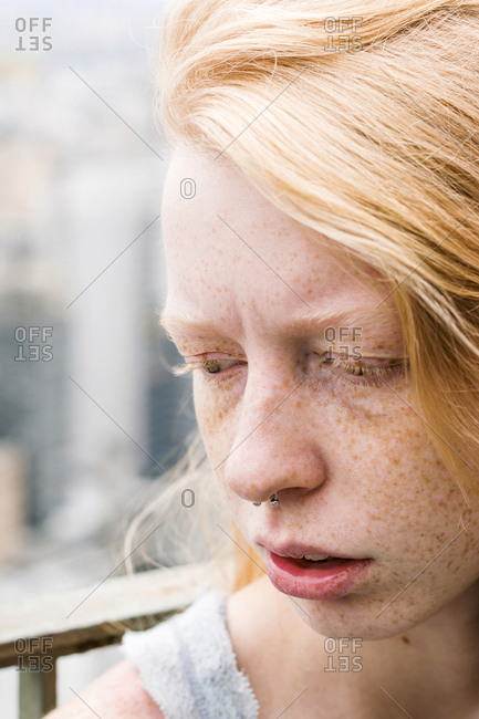 Freckled woman in close up with nose ring