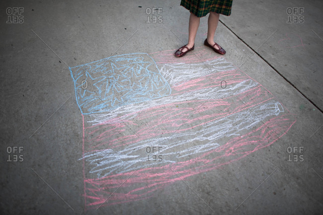 Girl by American flag drawing