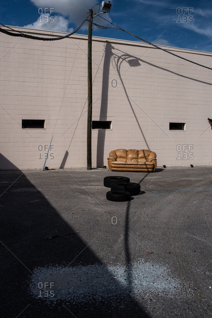 Car tires and sofa in a parking lot