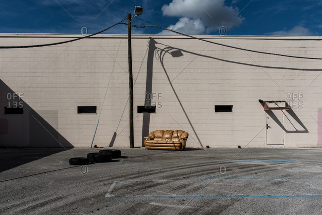 Sofa and tires in a parking lot