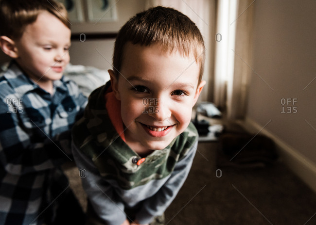 Two little boys goofing around