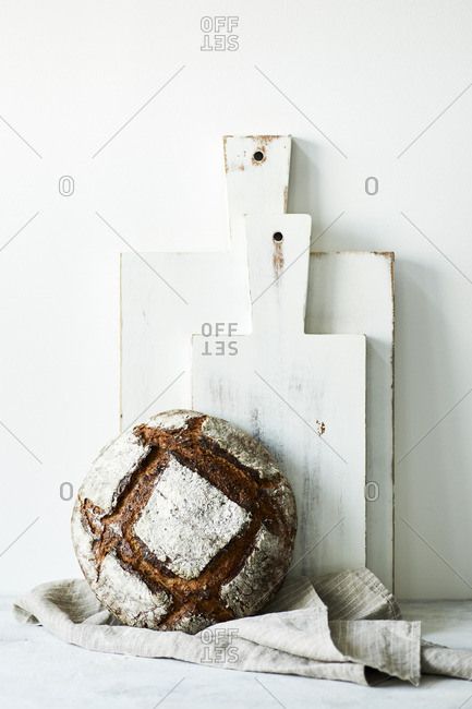 Still life of artisan sourdough rye boule