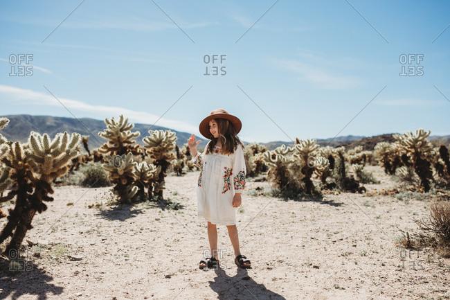 Young girl walking through the desert in Joshua Tree National Park