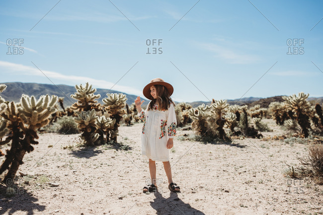 Young girl walking through the desert in Joshua Tree National Park