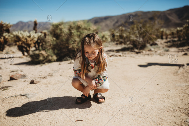 Young girl exploring in the desert at Joshua Tree National Park