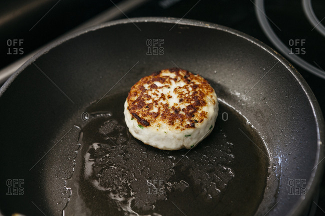 Seafood cake seared in hot pan with oil