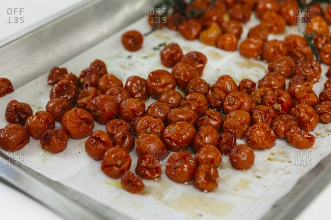Roasted cherry tomatoes on baking sheet