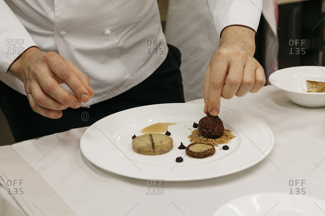 Chef preparing a plate with sweet desserts