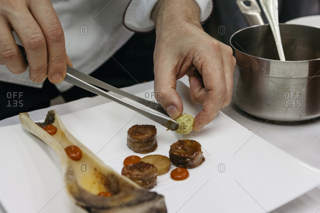 Chef preparing bone marrow dish