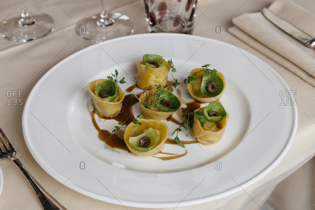 Plate of homemade tortellini served at table