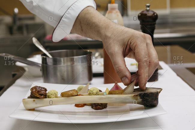 Chef arranging ingredients inside bone