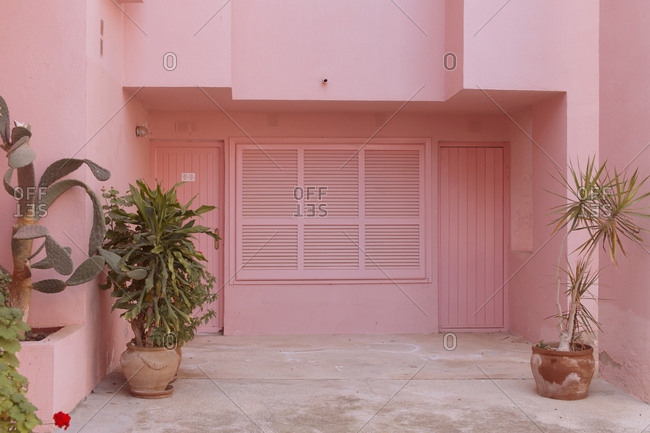 Entrances to apartments in an all pink building