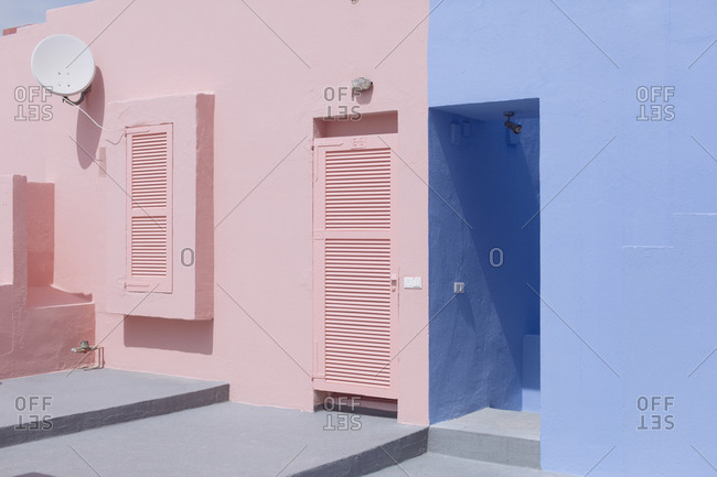 Exterior of buildings painted blue and pink