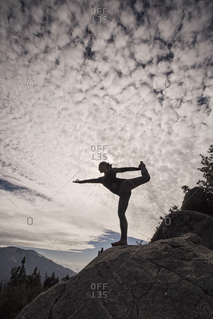 A Woman Practices Yoga On Cliff In Sequoia National Park, California