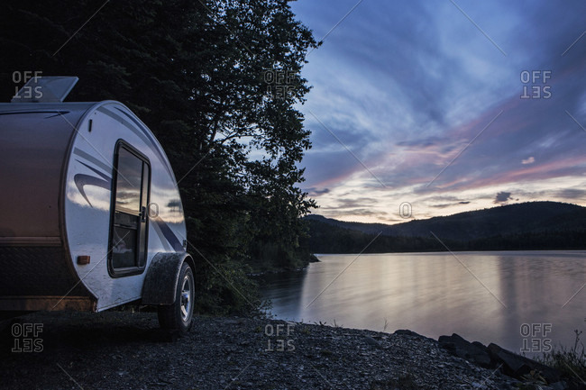 A Teardrop Camper Parked Next To Lake At Sunset In Deboullie Public Reserved Land, Maine