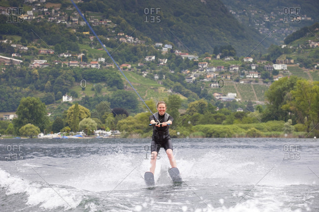 A Smiling Female Water Skiing On Lake Maggiore, Canton Ticino