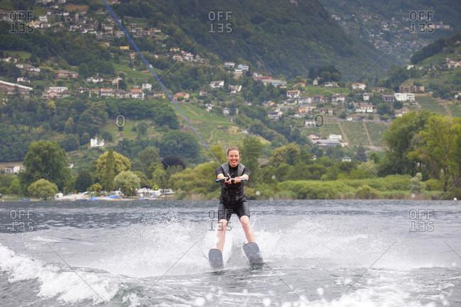 A Smiling Female Water Skiing On Lake Maggiore, Canton Ticino