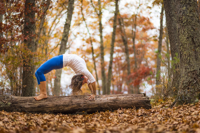 A Woman Doing Yoga During Autumn In New England