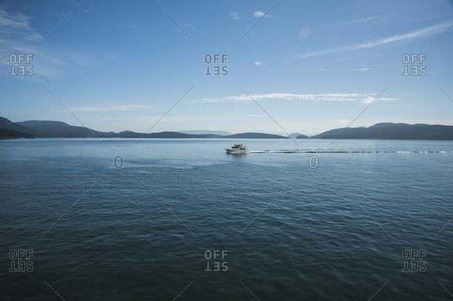 Yacht on blue idyllic water at San Juan Islands