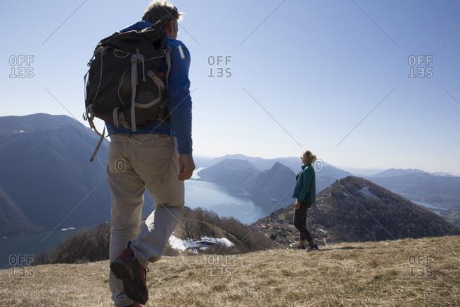 Hikers in mountain meadow in winter