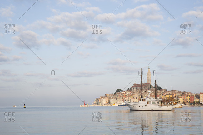 Rovinj, Turin, Croatia - November 18, 2013: View across harbour to old town of Rovinj at sunset