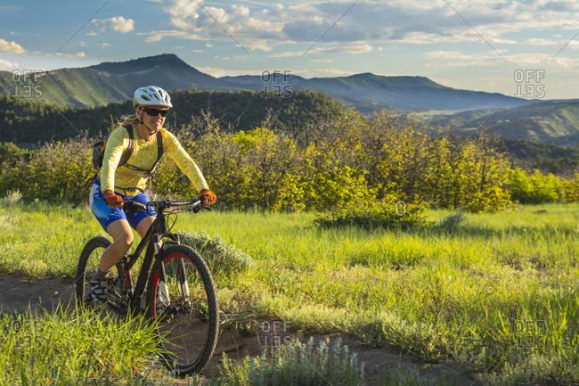 A woman mountain biking on the Horse Gulch Trail System, Durango, Colorado