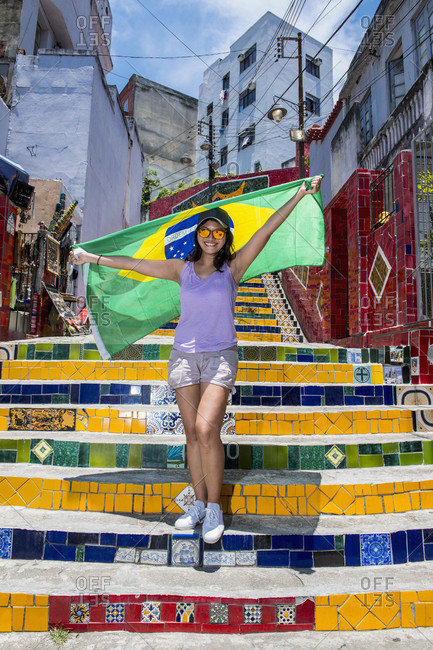 Woman With Brazilian Flag Standing On Escadaria Selaron Stairs In Santa Teresa