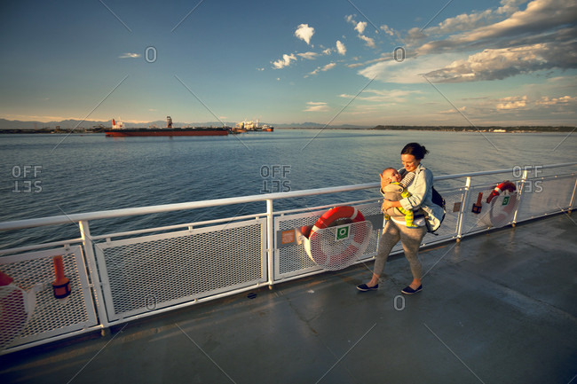 A Mother Walking With Her Son On The Deck Of A BC Ferries Vessel As It Leaves Duke Point Harbor