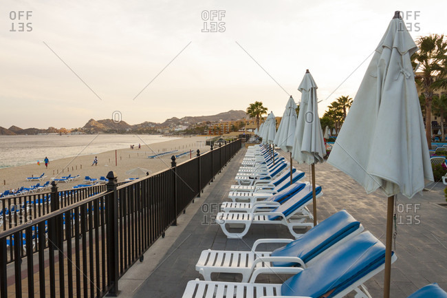 Cabos San Lucas, Baja California peninsula, Canada - June 13, 2015: Beach Chairs Lined Up At Resort In Cabos San Lucas, Baja California Peninsula, Mexico