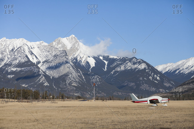 A Aircraft Parked On An Open Field At Jasper Airport In Jasper National Park, Canada
