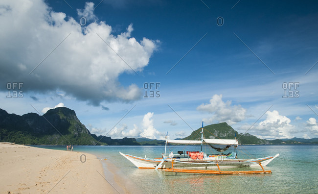 Boat Tied Up To Sandy Tropical Beach In El Nido, Philippines