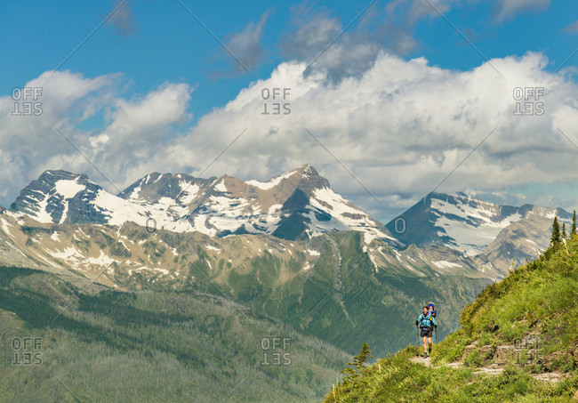Women And Child Hiking On The Highline Trail In Glacier National Park, Montana, Usa