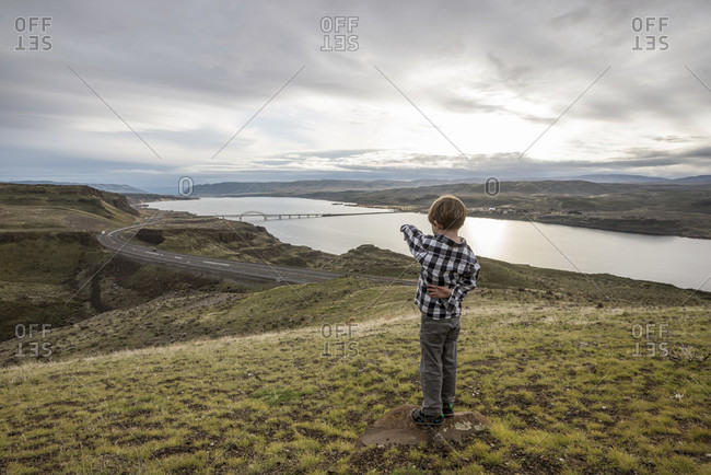 A Boy Pointing To The View Over The Columbia River In Washington, Usa