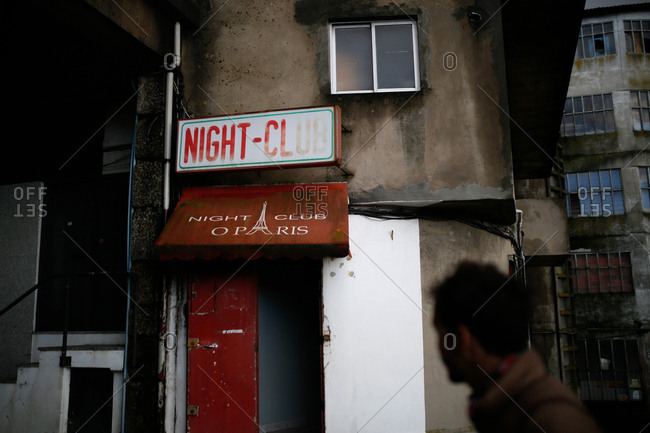 May 4, 2016 - Guimaraes, Portugal: Open door with sign for nightclub