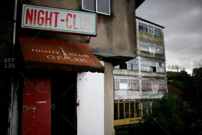 May 4, 2016 - Guimaraes, Portugal: Ramshackle building with doorway advertising nightclub