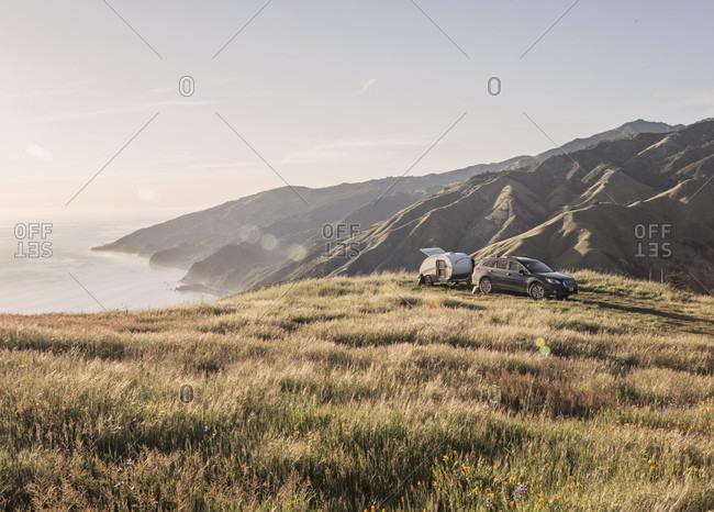 A Station Wagon At Campsite Along California's Big Sur Coast