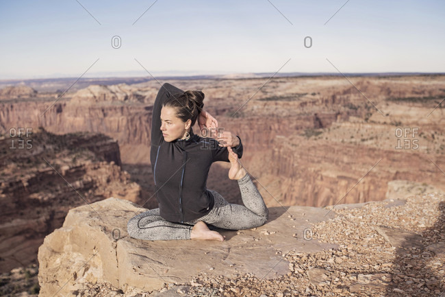 A Young Woman Practices Yoga In Canyon lands National Park, Utah
