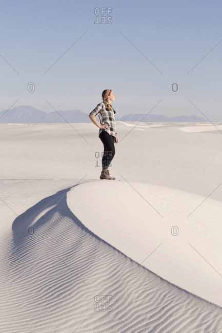 A Woman Standing On A Dune In White Sands National Monument, New Mexico