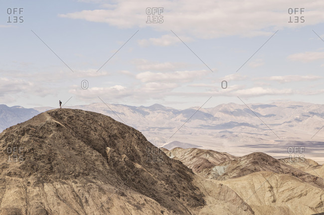 A Hiker Standing On Peak Desolation Canyon Trail In California's Death Valley National Park