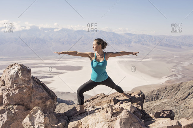 A Fit Young Woman Practices Yoga In Death Valley National Park, California