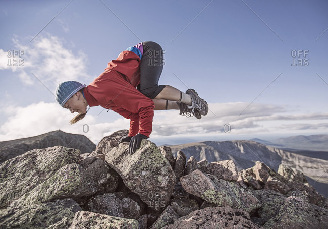 A Woman Practices Yoga On The Knife Edge, Mount Katahdin, Maine