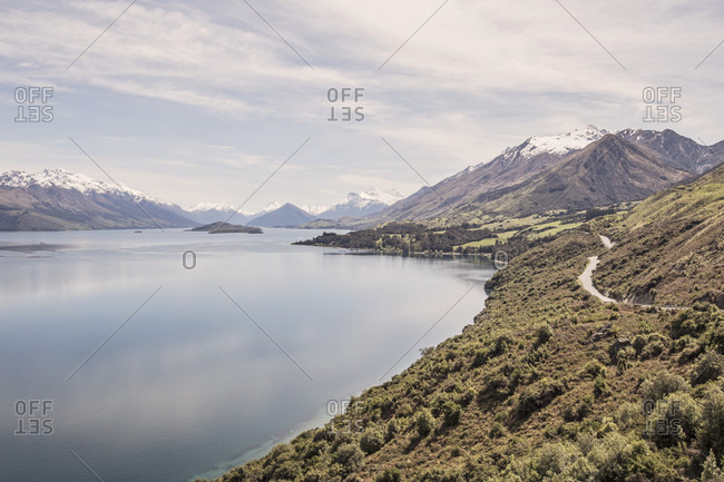 The Southern Alps Tower Over Lake Wakatipu On New Zealand's South Island