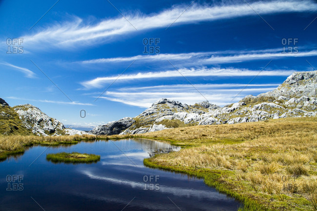 Clouds Sweep Over The Alpine Tarns Of Mount Owen, New Zealand