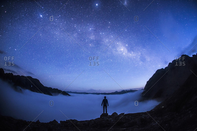Silhouette Of A Person Exploring Landscape Under Starry Sky