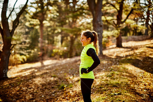 A Smiling Female Athlete Standing In A Part At Arnold Arboretum