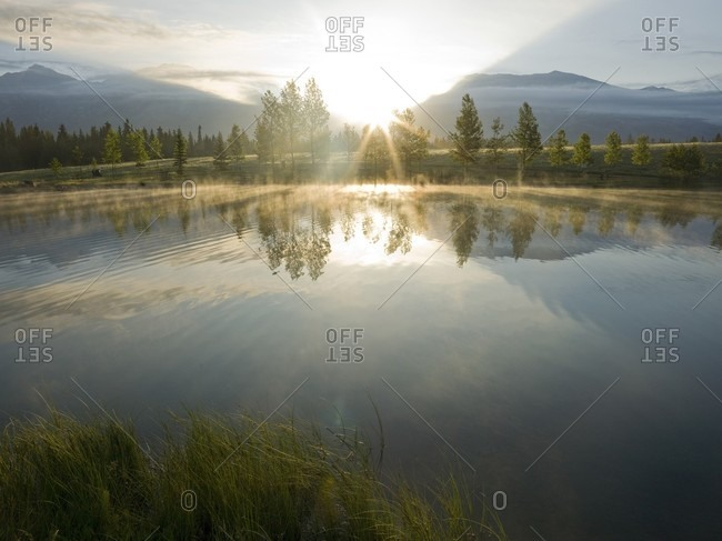Sunrise reflected in mountain lake