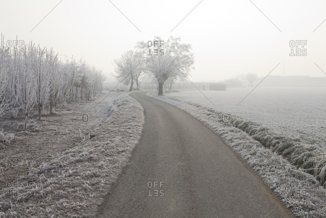 View down rural road on icy day