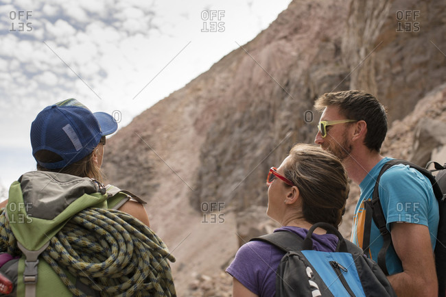 A Group Of Climbers Survey A Wall At The Owens River Gorge For The Next Route To Climb