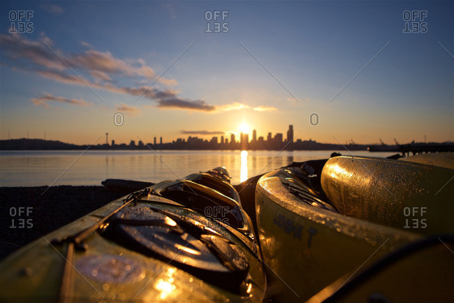 Distant Sunrise Seen From Seacrest Marina With Kayaks And Seattle Skyline